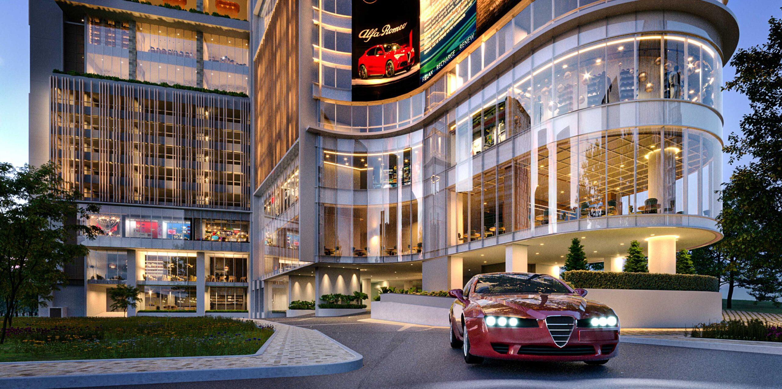 A red Alfa Romeo car at the entryway of Alfa Bangsar at night. The Ultimate Urban Lifestyle.