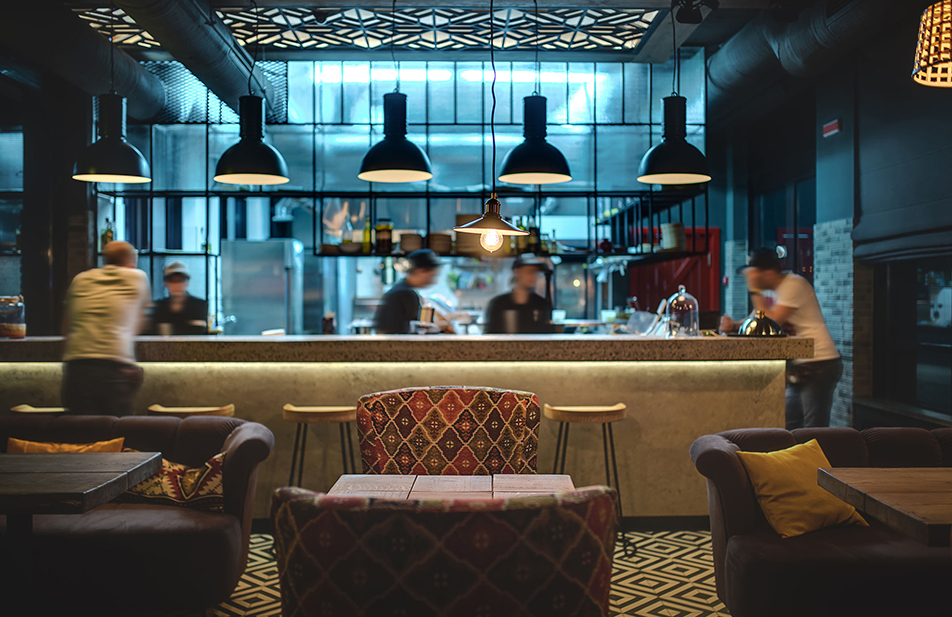 A restaurant area in Bangsar with employees and some customers.