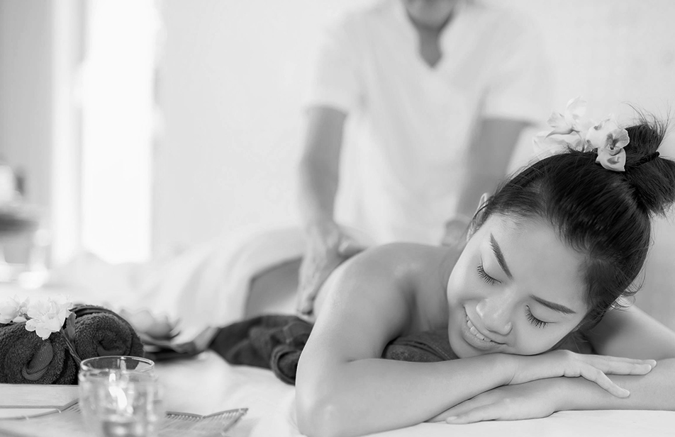 A woman smiling while getting a massage at Alfa Bangsar.