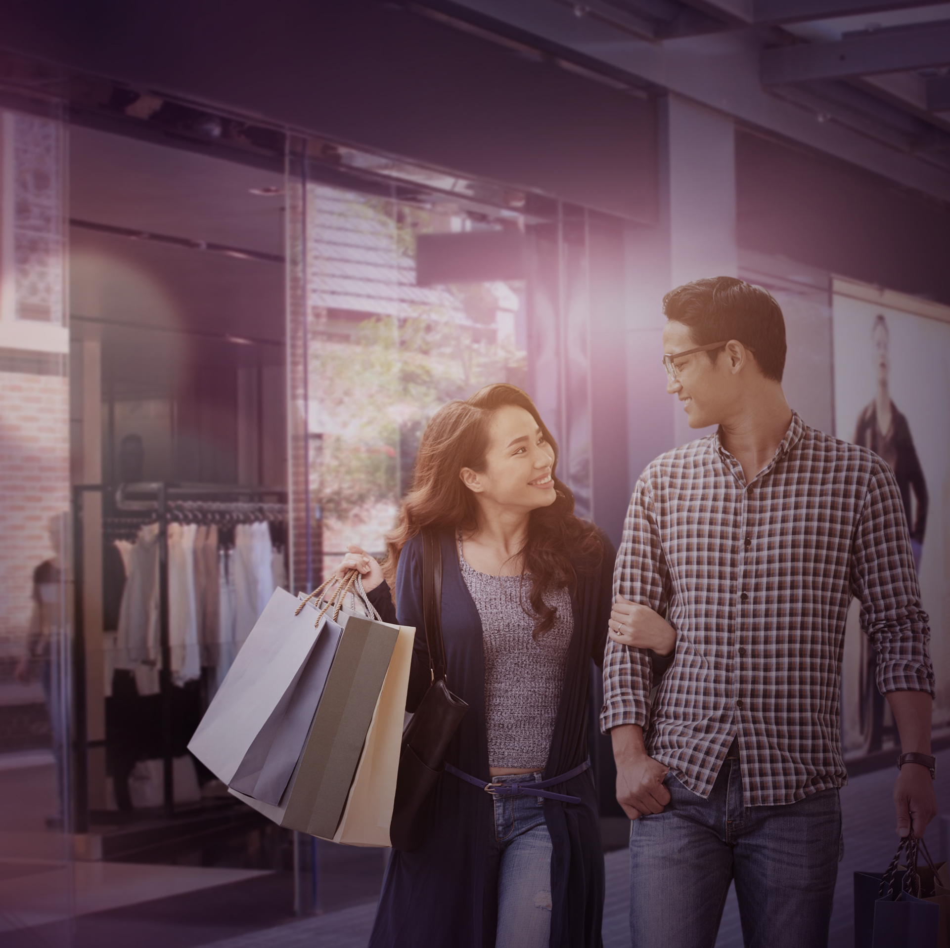 A couple holding hands while shopping in Bangsar