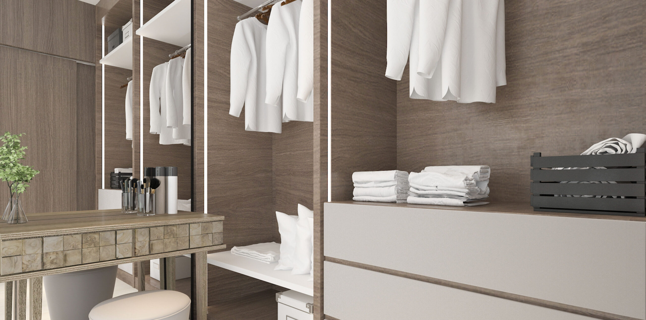 Wardrobe with clothes, towels and pillows next to a make up area and a mirror.